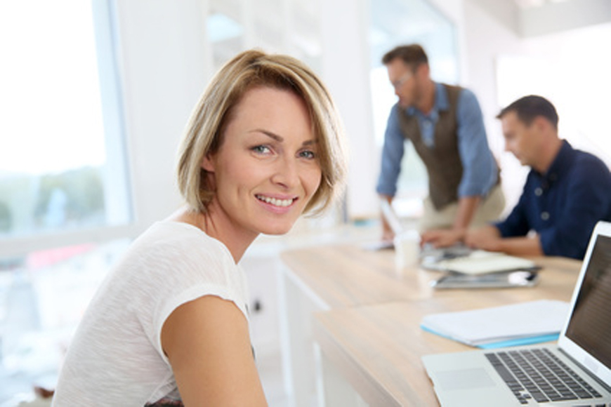 Portrait of smiling woman working in office